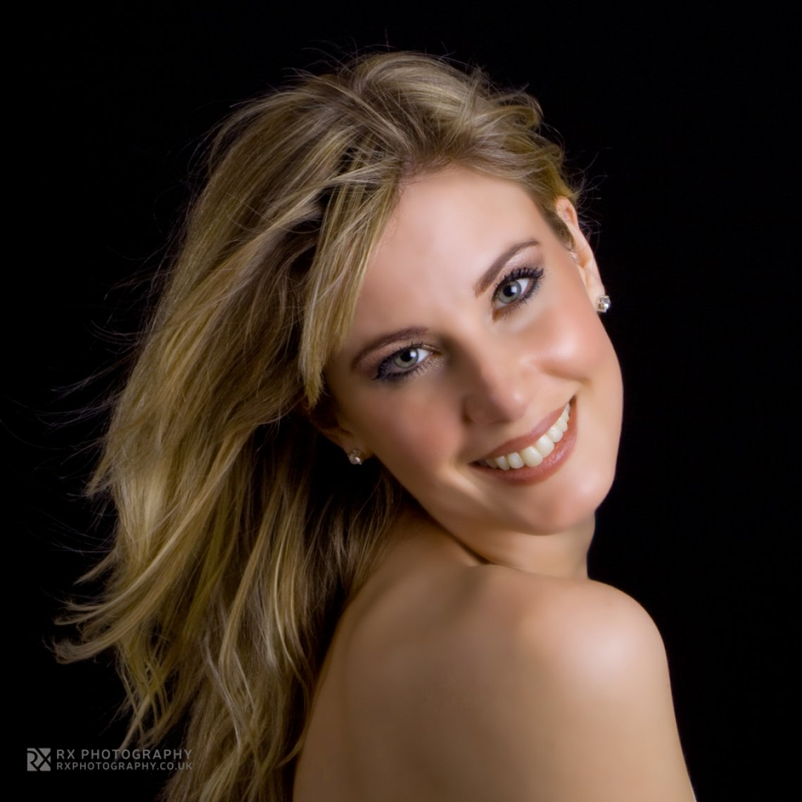 RX Photography - beautiful blonde woman looking over her shoulder