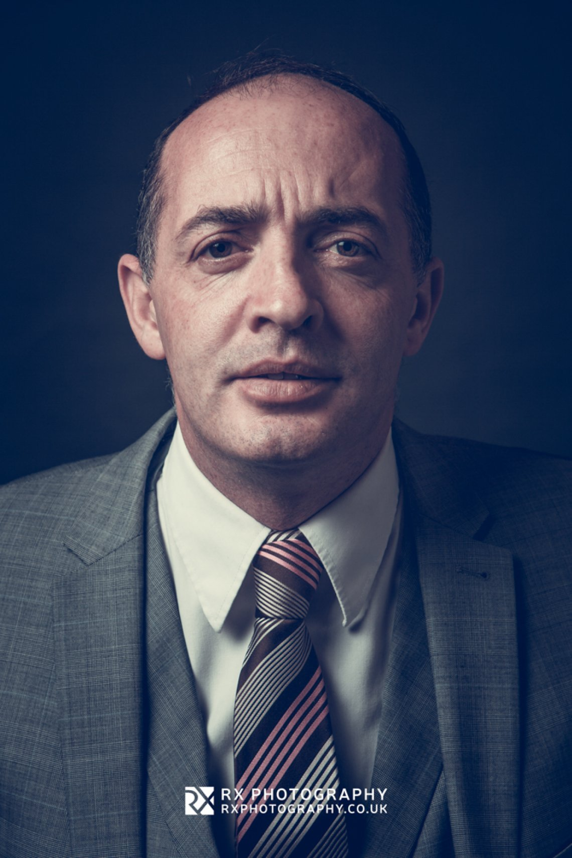RX Photography portrait headshot of male in suit